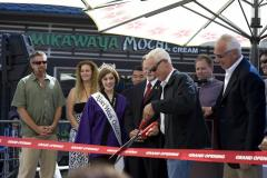 jim_smith_who_headed_up_the_renovation_of_japanese_village_plaza_has_the_honor_of_cutting_the_ceremonial_ribbon