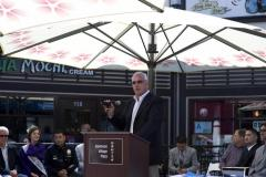 marvin_lotz_president_of_american_commercial_equities_management_llc_speaks_to_the_crowd_at_the_grand_re-opening